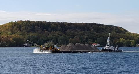 Tug and barge move aggregates in front of Amherst Island