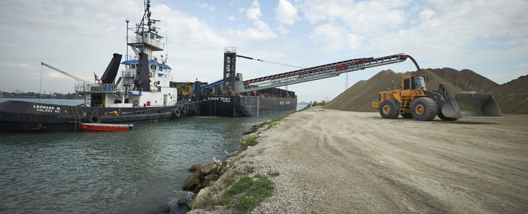 Image of Huron Spirit Barge unloading aggregates.
